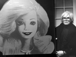 andy-warhol-displaying-his-portrait-of-a-barbie-doll
